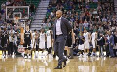 Brooklyn Nets head coach Jason Kidd walks onto the court during a timeout in the first half of an NBA basketball game against the Utah Jazz Wednesday, Feb. 19, 2014, in Salt Lake City. (AP Photo/Jim Urquhart)