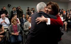 British Columbia Premier Christy Clark, right, embraces Dr. Julio Montaner, director for the B.C. Centre for Excellence in HIV/AIDS, after announcing the dedicated AIDS ward at St. Paul's Hospital would no longer just treat patients with HIV/AIDS because of a lack of demand due to the success of the centre, during a news conference in Vancouver, B.C., on Tuesday May 27, 2014. THE CANADIAN PRESS/Darryl Dyck
