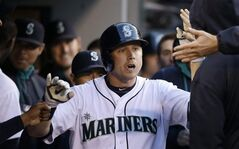 Seattle Mariners' Justin Smoak is congratulated on his home run against the Los Angeles Angels in the fourth inning of a baseball game Tuesday, May 27, 2014, in Seattle. (AP Photo/Elaine Thompson)