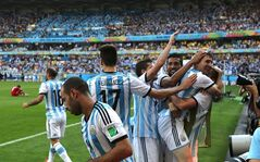 Argentina's Lionel Messi, second right, celebrates after scoring during the group F World Cup soccer match between Argentina and Iran at the Mineirao Stadium in Belo Horizonte, Brazil, Saturday, June 21, 2014. Argentina won 1-0. (AP Photo/Jon Super)
