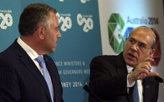 Secretary-General of Organization for Economic Co-operation and Development Angel Gurria, right, speaks with Australia's Treasurer Joe Hockey during the G20 Finance Ministers and Central Bank Governors meeting in Sydney, Australia, Friday, Feb. 21, 2014.(AP Photo/Rob Griffith)