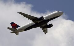 This Aug. 20, 2012 photo, shows a Delta Airlines aircraft taking off at Miami International Airport in Miami. THE CANADIAN PRESS/AP, Alan Diaz