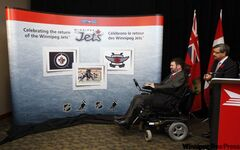 MP Steven Fletcher, left, was on hand with Canada Post president and CEO Deepak Chopra at the MTS Centre to unveil three new postage stamps featuring the Winnipeg Jets.