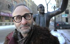 Writer-actor Alon Nashman with a statue of his muse, John Hirsch.