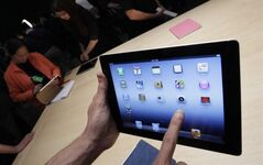 A new Apple iPad is on display during an Apple event in San Francisco in this March 7, 2012 file photo. (AP Photo/Paul Sakuma, File)
