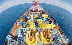 Passengers get ready to race down the 93.3-metre-long waterslide on Carnival Dream, the newest ship of Carnival Cruise Lines, named for Best Main Dining by Cruise Critic.