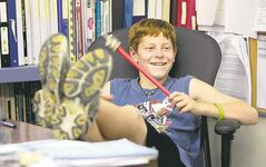 Griffin takes advantage of the last day of school to put his feet up on the teacher's desk.