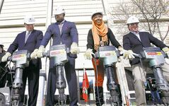 From left, David Barnard, Israel Idonije, UMSU president Bilan Arte and David Asper use jackhammers to break ground for the Active Living Centre.