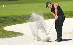 Tiger Woods blasts out of the 10th bunker Monday: he effectively had this tournament in the bag on Sunday.