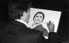 Justin Trudeau signing Holmes' drawing of him.