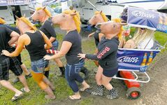 Festivalgoers horse around at the Countryfest site Saturday.