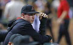 Arizona Diamondbacks first baseman Paul Goldschmidt watches the baseball game against the Pittsburgh Pirates with a cast on his hand, Saturday, Aug. 2, 2014, in Phoenix. (AP Photo/The Arizona Republic, David Kadlubowski)