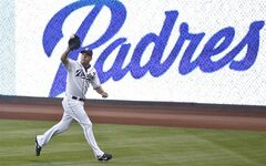 San Diego Padres right fielder Seth Smith runs down a line drive in the right field corner to take a hit away from Cincinnati Reds' Brandon Phillips in the second inning of a baseball game Monday, June 30, 2014, in San Diego. (AP Photo/Lenny Ignelzi)