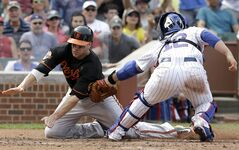 Chicago Cubs catcher John Baker, right, tags out Baltimore Orioles' Chris Davis at home during the fifth inning of an interleague baseball game in Chicago, Friday, Aug. 22, 2014. (AP Photo/Nam Y. Huh)