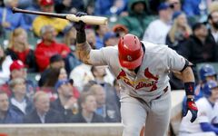 St. Louis Cardinals' Yadier Molina slams his bat to the ground after flying out with Matt Holliday on-base during the eighth inning of a baseball game against the Chicago Cubs, Friday, May 2, 2014, in Chicago. The Cubs won 6-5. (AP Photo/Charles Rex Arbogast)