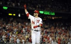 Washington Nationals' Bryce Harper gestures as he celebrates his home run against the Milwaukee Brewers during the ninth inning of a baseball game, Friday, July 18, 2014, in Washington. The Brewers won 4-2. (AP Photo/Nick Wass)