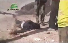 In this amateur video provided by a group which calls itself Ugarit News, Syrian rebels attend to one of their own who has been shot during a raid on the village of Hatla, Syria, Wednesday, June 12, 2013. On Wednesday, activists said Syrian rebels battled Shiites in Hatla, in the country's east, killing more than 60 people, including civilians. The content has been authenticated based on its translation and content has been checked by regional experts against known locations and events, and is consistent with independent Associated Press reporting. (AP Photo/Amateur video via Ugarit News)