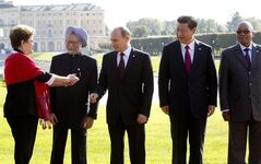 FILE - In this Sept. 5, 2013 file photo, from left, Brazil's President Dilma Rousseff gestures to then Indian Prime Minister Manmohan Singh, Russia's President Vladimir Putin, China's President Xi Jinping and South African President Jacob Zuma, as they gather for a group photo after a BRICS leaders' meeting at the G-20 Summit in St. Petersburg, Russia. In another sign of the shifting balance of power in the world economy, emerging market powers Brazil, Russia, India, China and South Africa are launching a $100 billion development bank to challenge the U.S.-dominated World Bank and help finance $4.5 trillion worth of infrastructure projects. (AP Photo/Sergei Karpukhin, Pool, File)