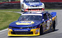 Chase Elliott drives through a corner during practice for the NASCAR Nationwide Series Nationwide Children's Hospital 200 auto race at Mid-Ohio Sports Car Course Friday, Aug. 15, 2014 in Lexington, Ohio. (AP Photo/Tom E. Puskar)