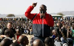 Former youth leader of the African National Congress (ANC) Julius Malema addresses mine workers at the Lonmin mine near Rustenburg, South Africa, Saturday. (AP Photo/Themba Hadebe)