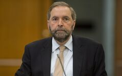 Official Opposition Leader Tom Mulcair waits to appear at Commons house affairs committee to explain the use of House of Commons resources by the Official Opposition Thursday May 15, 2014. THE CANADIAN PRESS/Adrian Wyld