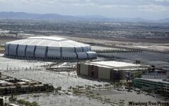 FILE - In tis Friday, Jan. 22, 2010, file photo, Jobing.com Arena, right, owned by the city of Glendale, Ariz., where the Phoenix Coyotes hockey team currently plays home games, and University of Phoenix Stadium,  left, where the Arizona Cardinals football team plays are shown in Glendale.