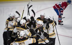 Montreal Canadiens captain Brian Gionta watches members of the Boston Bruins celebrate a goal by Matt Fraser during period period overtime in NHL playoff hockey action Thursday, May 8, 2014 in Montreal. The Bruins tied the series at 2-2. THE CANADIAN PRESS/Paul Chiasson