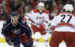 Columbus Blue Jackets' Corey Tropp (26) keeps an eye on the puck while skating against Carolina Hurricanes' Justin Faulk (27) during the first period of an NHL hockey game in Raleigh, N.C., Saturday, March 29, 2014. THE CANADIAN PRESS AP/Gerry Broome