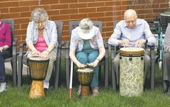 The drum therapy sessions are aimed at a variety of age groups, from at-risk children, adult executives or this group from Lindenwood Manor.