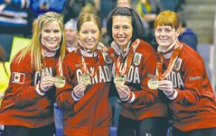 From left, skip Jennifer Jones and her team, Kaitlyn Lawes, Jill Officer and Dawn McEwen celebrate after defeating Sherry Middaugh in the women's final of Roar of the Rings curling at the MTS Centre on Sat., Dec. 7, 2013 to win the right to represent Canada at the Winter Olympics in Sochi, Russia, in February.