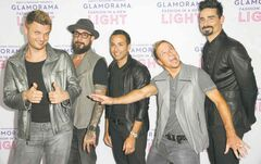 From left, Nick Carter, AJ McLean, Howie Dorough, Brian Littrell, and Kevin Richardson of The Backstreet Boys arrive at the Macy's Passport's Glamorama at The Orpheum Theatre on thursday, Sept. 12, 2013 in Los Angeles. (Photo by Richard Shotwell/Invision/AP)
