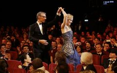 Master of Ceremonies Lambert Wilson, left, and actress Nicole Kidman during the opening ceremony ahead of the screening of Grace Of Monaco at the 67th international film festival, Cannes, southern France, Wednesday, May 14, 2014. (AP Photo/Thibault Camus)