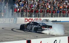 Jimmie Johnson does a burn-out after winning the NASCAR Sprint Cup series auto race at Dover International Speedway, Sunday, June 1, 2014, in Dover, Del. (AP Photo/Molly Riley)