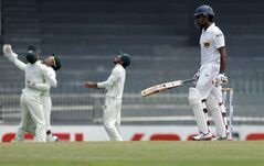 Sri Lanka's Kumar Sangakkara Lahiru Thirimanne, right, leaves after being dismissed as Bangladesh players celebrate, background, during the second day of the second test cricket match between Sri Lanka and Bangladesh in Colombo, Sri Lanka, Sunday, March 17, 2013. (AP Photo/Eranga Jayawardena)