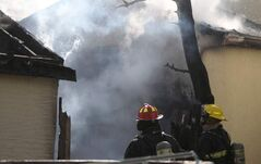 Firefighters on the scene of a blaze on the 800 block of Home Street, Friday.