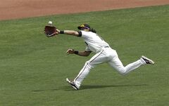 San Francisco Giants center fielder Angel Pagan makes a running catch on a fly ball hit by Colorado Rockies' Brandon Barnes during the second inning of a baseball game in San Francisco, Saturday, June 14, 2014. (AP Photo/Jeff Chiu)
