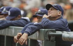 San Diego Padres manager Bud Black, right, and bench coach Dave Roberts, second from right, rest on the dugout railing in the first inning of their baseball game against the San Francisco Giants Wednesday, June 25, 2014, in San Francisco. San Francisco won the game 4-0. The Giants' Tim Lincecum threw his second career no-hitter. (AP Photo/Eric Risberg)