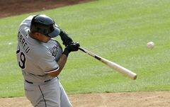 Chicago White Sox's Jose Abreu breaks his bat as he flies out to left field against the Houston Astros in the fifth inning of a baseball game, Saturday, May 17, 2014, in Houston. (AP Photo/Pat Sullivan)