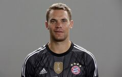 In this picture taken Saturday, Aug. 9, 2014, Bayern Munich's Manuel Neuer poses during an official photo shooting for the new German first division Bundesliga soccer season in Munich, southern Germany. World Cup-winning goalkeeper Neuer has been named Germany's footballer of the year in an annual poll of sports journalists. Kicker magazine said Sunday, Aug. 10, 2014, that the Bayern Munich keeper received 144 out of 701 votes in its poll. He finished nine votes ahead of Borussia Dortmund forward Marco Reus, who missed the World Cup because of a knee injury suffered in Germany's final warm-up match. (AP Photo/Matthias Schrader)