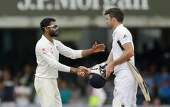 India's Ravindra Jadeja, left, shakes hands with England's James Anderson after running him out to win the test match on the fifth day of the second cricket test match between England and India at Lord's cricket ground in London, Monday, July 21, 2014. India won the match by 95 runs. The International Cricket Commission (ICC) has set next Tuesday as the date for a disciplinary hearing against James Anderson for shoving India's Ravindra Jadeja during the first test. (AP Photo/Matt Dunham)