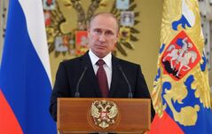 FILE - In this June 26, 2014, file photo, Russian President Vladimir Putin addresses graduates of military academies in Moscow's Kremlin. In a statement published on the Kremlin website on Friday, July 4, 2014, Putin said