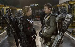 This image released by Warner Bros. Pictures shows Emily Blunt, left, and Tom Cruise in a scene from