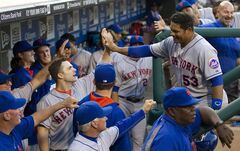 New York Mets' Bobby Abreu, right, gets congratulations from the dugout as he scores a run on the double by Lucas Duda during the second inning of a baseball game against the Philadelphia Phillies, Monday, June 2, 2014, in Philadelphia. (AP Photo/Chris Szagola)