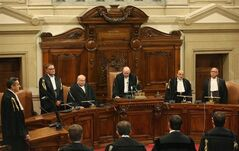 Italy's highest court President Antonio Esposito, third right, read the sentence confirming a four year term for Italian media Mogul and former Premier Silvio Berlusconi for tax fraud in Rome, Thursday, Aug. 1, 2013. Italy's highest court upheld Berlusconi's four-year prison sentence for tax fraud, the first time the former premier and billionaire media mogul has definitely been convicted of any crime. The tensely awaited ruling, however, ordered a review a five-year ban on public office that was part of the lower court's sentence. (AP Photo/Alessandro Di Meo, pool)