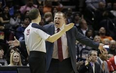 Chicago Bulls coach Tom Thibodeau, right, argues a call with official Mark Lindsay during the second half of an NBA basketball game against the San Antonio Spurs, Wednesday, Jan. 29, 2014, in San Antonio. (AP Photo/Eric Gay)