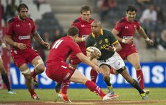 George North of Wales (11) and Cornal Hendricks of South Africa during their Rugby test match in Nelspruit, South Africa, Saturday, June 21, 2014. (AP Photo)