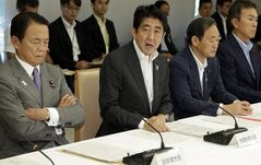 Japanese Prime Minister Shinzo Abe, second from left, speaks during a joint-meeting by Nuclear Emergency Response Headquarters and Nuclear Power Disaster Management Council at the prime minister's official residence in Tokyo Tuesday, Sept. 3, 2013. (AP Photo/Shizuo Kambayashi, Pool)