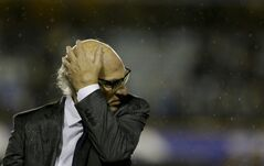 FILE - In this May 11, 2014 file photo, Boca Juniors' coach Carlos Bianchi leaves the filed after defeating Lanus 3-1 at an Argentine league soccer match in Buenos Aires, Argentina. (AP Photo/Natacha Pisarenko, File)