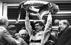 FILE - In this May 13, 1984, file photo, Brazilian Formula One race driver Ayrton Senna da Silva, center, holds up the winner's crown after he won the Mercedes 190 E race in Nuremberg, Germany ahead of former world champion Niki Lauda, second from left. At the right, smiling German transport minister Werner Dollinger. Senna won three Formula One titles — in 1988, 1990 and '91 — all with McLaren. He moved to the Williams team for his tragic 1994 season. Despite his career being cut short when he was 34, his 41 wins stand third all-time behind Michael Schumacher's 91 and rival Alain Prost's 51. He died at the 1994 San Marino Grand Prix. (AP Photo/Udo Weitz, File)