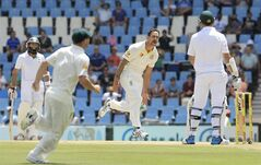 Australia's bowler Mitchell Johnson, center, celebrates after dismissing South Africa's captain Graeme Smith, right, for 4 runs on the fourth day of their their cricket test match against South Africa at Centurion Park in Pretoria, South Africa, Saturday, Feb. 15, 2014. (AP Photo/Themba Hadebe)